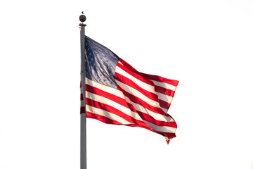 American flag on pole flowing in the wind