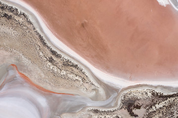 Deurstickers Zalm Abstract top down view of a large pink salt lake located next to highway 40 in the wheatbelt region of Western Australia