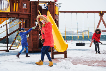children having fan with snow balls in winter