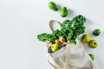 Cotton bag with green fruit and vegetables