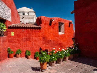 outdoor patio with flowers in pots that connects the rooms of the Saint Catherine Monastery. A monastery of nuns of the Dominican in Arequipa city, Peru.
