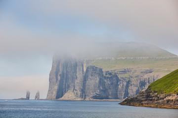 Faroe islands coastline cliffs landscape. Rising og kelling stacks.