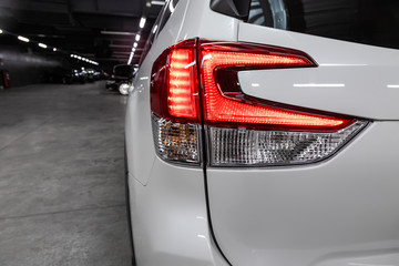 Close-up taillight of a new halogen white crossover car. Exterior of a modern car.