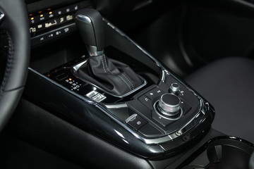 Close-up of the accelerator handle and buttons with  modern central console with  controls. automatic transmission gear of car , car interior.