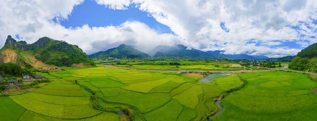 Aerial view of Fansipan mountain hills valley on summer with paddy rice terraces, green agricultural fields in rural area in travel trip and holidays vacation concept, Sapa, Vietnam. Nature landscape. Fototapete