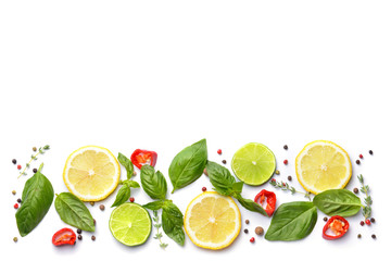 Citrus fruits with different spices on white background