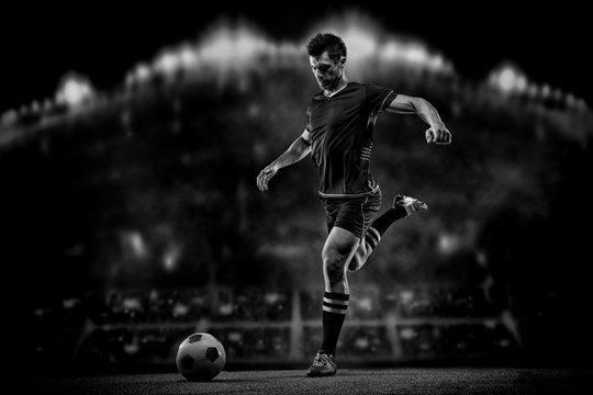 soccer player on black background