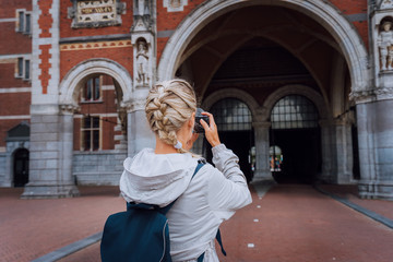 Woman tourist visiting museum in Amsterdam. Travel in Europe city trip concept