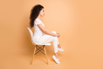 Full size profile photo of amazing lady sitting comfy chair looking strict to empty space not...