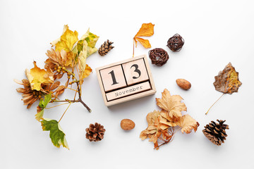 Wall Mural - Composition with autumn leaves and calendar on white background