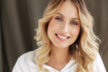 Close up of a beautiful smiling blonde woman