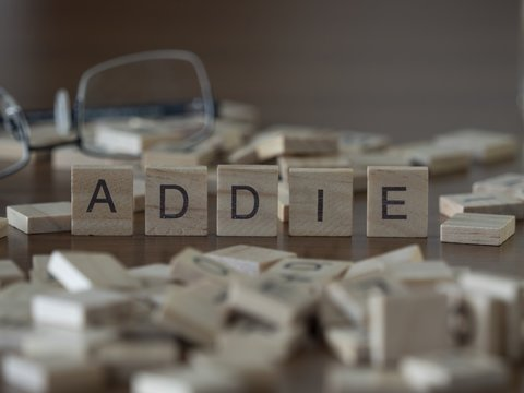 The concept of Addie represented by wooden letter tiles