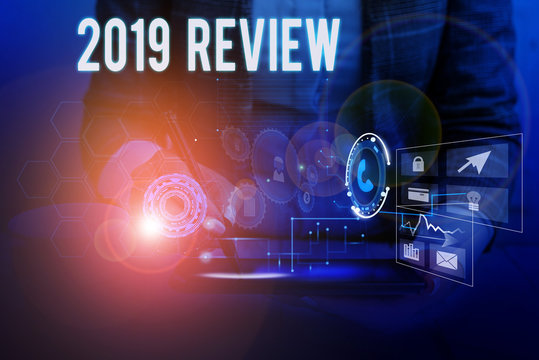 Text sign showing 2019 Review. Business photo showcasing New trends and prospects in tourism or services for 2019 Woman wear formal work suit presenting presentation using smart device