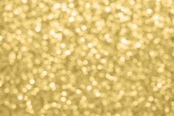 Abstract blur gold glitter sparkle defocused bokeh light background