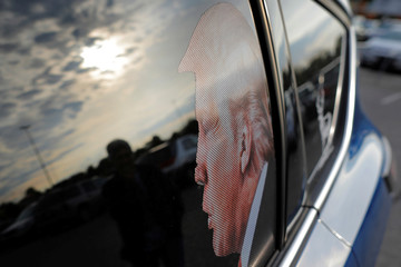 A car with an image of U.S. President Donald Trump on the window is parked at a shopping center in Saginaw Township