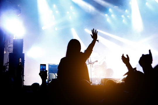 Silhouette of crowd concert, music fans on show.