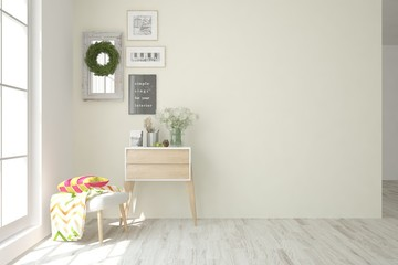 Empty room in white color with table ant pictures on a wall. Scandinavian interior design. 3D illustration