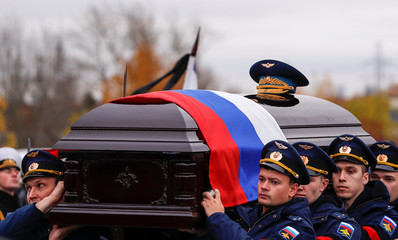 Officers carry a coffin of Alexei Leonov, the first man to conduct a space walk in 1965, during his funeral in Mytishchi, outside Moscow