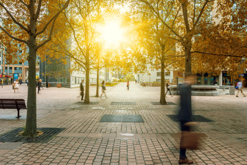 Silhouettes of people walking in the street near skyscrapers, modern office buildings and trees business district. City and nature, finances, business concept illustration