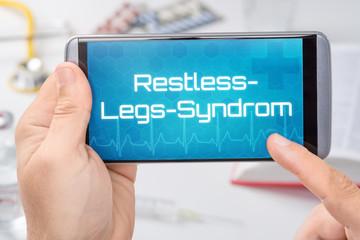 Smartphone mit dem Text Restless-Legs-Syndrom auf dem Display