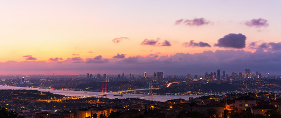 Fototapeta The Bosphorus Bridge and the night lights of Istanbul, aerial panorama obraz