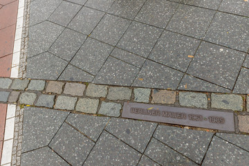 Plaque in the floor of Potsdamer Platz indicates the point where the famous Berlin Wall, Germany, passed