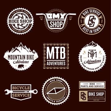 Set of vector bike shop, bicycle service, mountain biking clubs and adventures logo, badges and icons isolated on a brown background