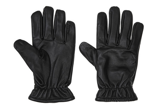 Black leather glove isolate on a white background. Black glove - keep/get gesture.
