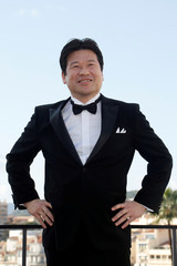 "Actor Jiro Sato poses during a photocall for the television series ""The Return"" during the annual MIPCOM television programme market in Cannes"