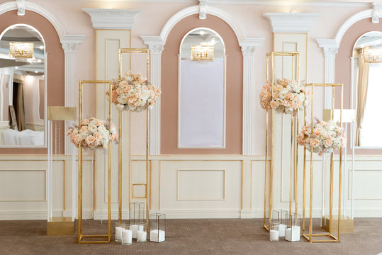 Luxury bouquets from fresh roses and carnations on metal designs. Decoration of a wedding ceremony