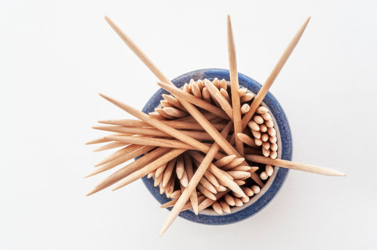 Toothpicks in round beaker, some sticking out