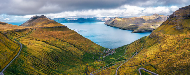 Wall Mural - Aerial panorama of mountains around village of Funningur on Faroe Islands