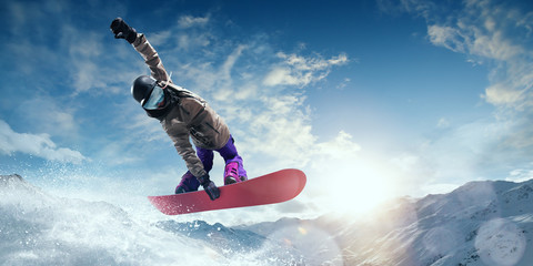 Snowboarder in action. Extreme winter sports. Wall mural