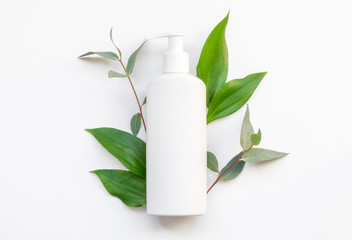 Natural organic cosmetic packaging plastic mock up with leaves. Mock-up bottle for branding.