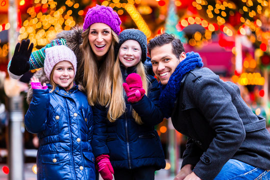 Family visiting traditional Christmas market