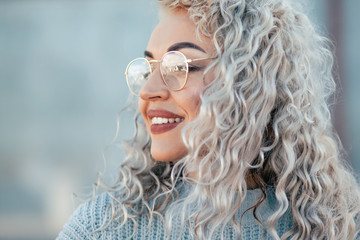 Obraz Plus size model with blond curly hair in knitted sweater outdoor - fototapety do salonu