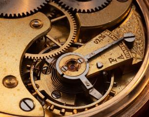 Close up of 100 year old pocket watch mechanics 3