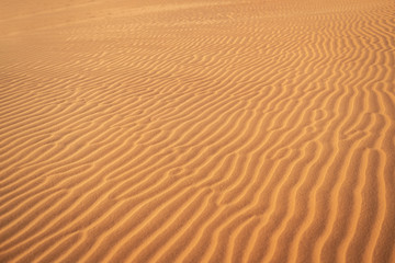 Abstract background and texture of sand waves in desert