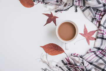 Cup of coffee and dried autumn leaves and scarf, Top view