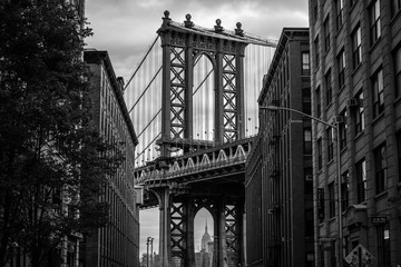View of one of the towers of the Manhattan Bridge from the streets of the DUMBO district, Brooklyn,...