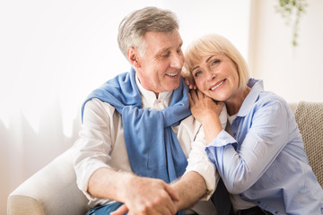 Happy mature couple enjoying time at home