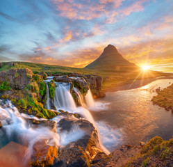 Fotobehang Watervallen Beautiful landscape with sunrise on Kirkjufellsfoss waterfall and Kirkjufell mountain, Iceland, Europe.