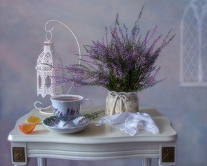 Still life with tea and  heather flowers on table