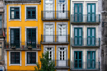 The facade of traditional building with beautiful windows at the Baixa neighborhood in the city of Porto, Portugal