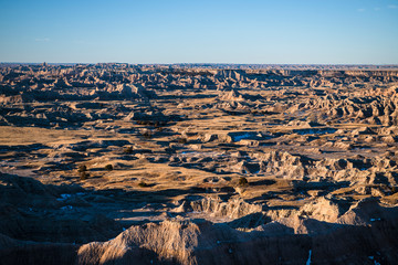 Scenic view of rocky landscape against sky at Badlands National Park