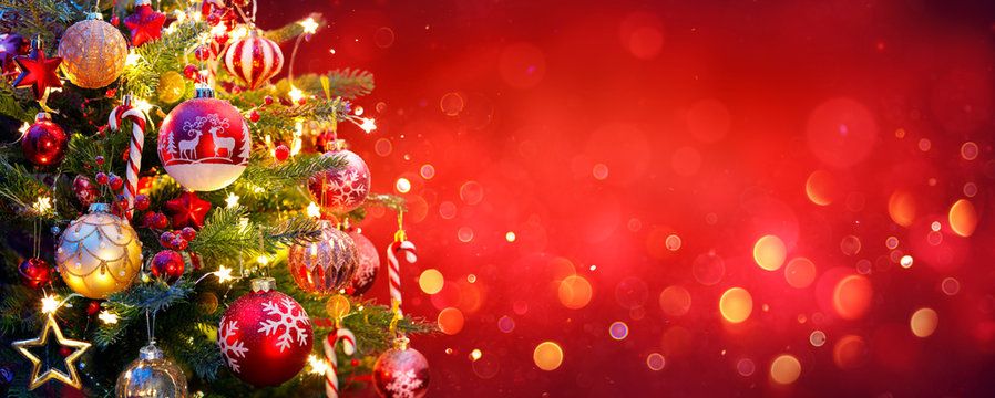Christmas Tree With Ornament And Bokeh Lights In Red Background