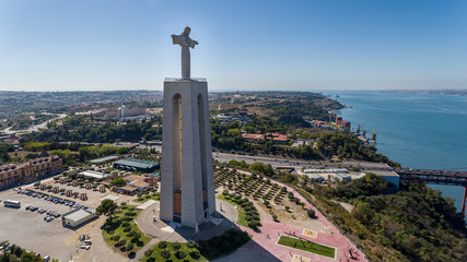 Aerial. Panorama from sky, a 25 de Abril Bridge and a statue of Jesus Christ. Lisbon.