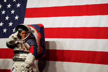 Advanced Space Suit Engineer at NASA Kristine Davis wears the xEMU prototype space suit for the next astronaut to the moon by 2024, during its presentation at NASA headquarters in Washington