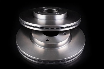 Steel brake discs for a passenger car. New spare parts for car repairs.