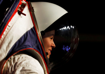 Advanced Space Suit Engineer at NASA Kristine Davis wears the xEMU space suit for the next astronaut to the moon by 2024,  during its presentation at NASA headquarters in Washington